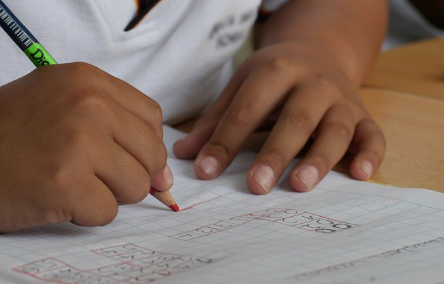 Small Child Working On Math Homework