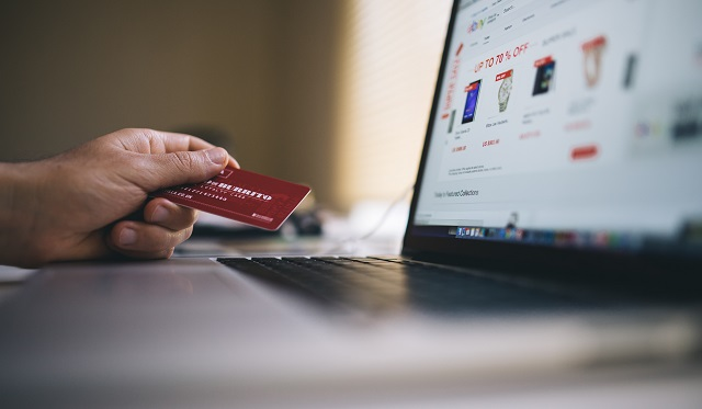 Person using credit card online
