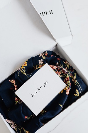 Silk dress in packing box with custom card on top