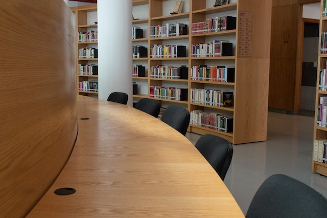 Public library desk and books