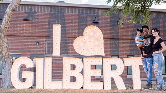 Family standing in front of I Love Gilbert sign