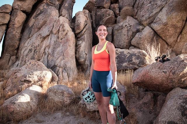 Lizzy VanPatten holding climbing gear