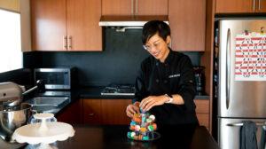 Anita Lee displaying macarons in kitchen