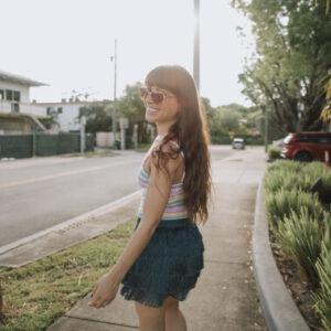Natasha Williams walking on sidewalk