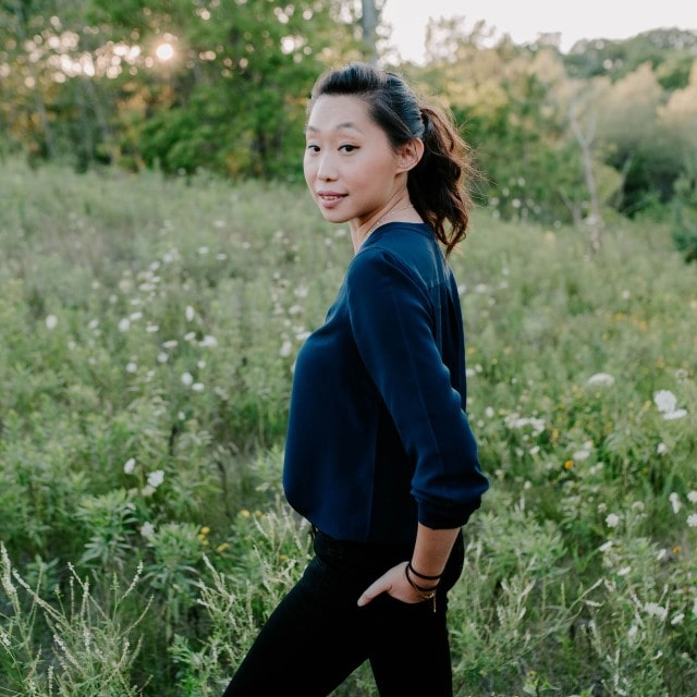 Annie Tang standing in a grassy field