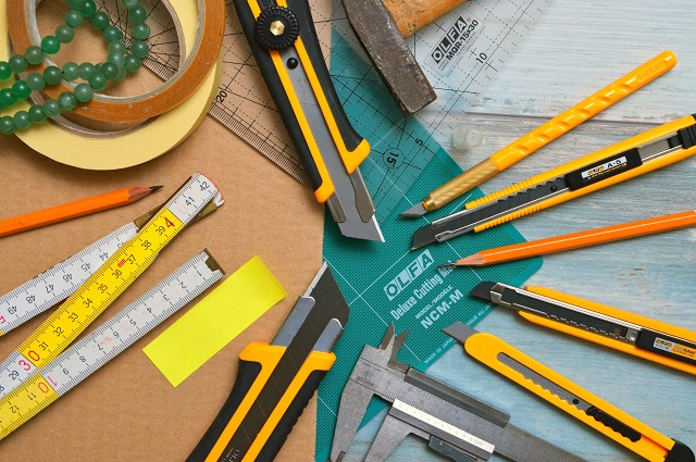 Pile of sewing tools on a desktop