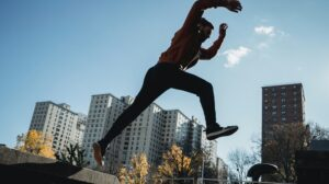 Man jumping from concrete ledge