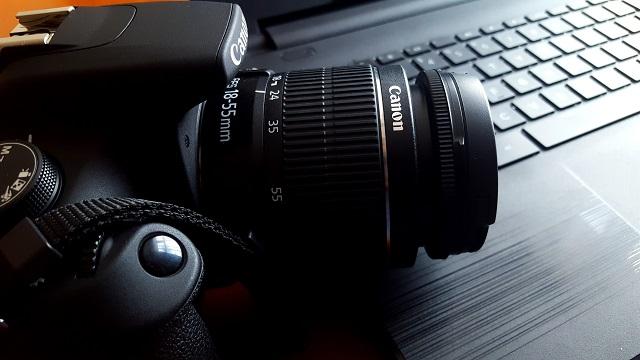 Camera resting on a laptop