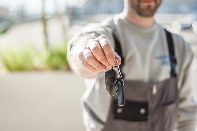 Man Handing Over New Car Keys