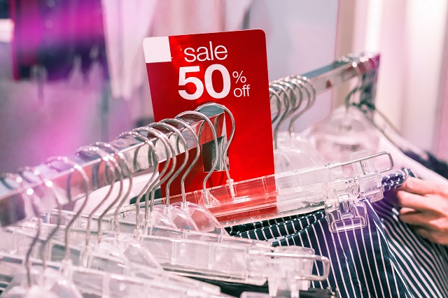 Clothing Rack With Sale Sign