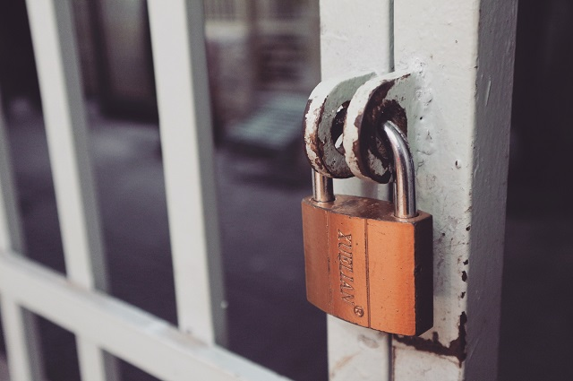 Padlock On A Gate Illustrating Website Trust