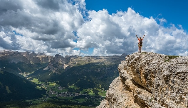 Woman Mountain Climbing Success Overlooking Valley