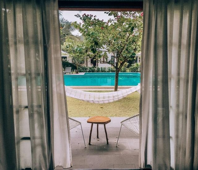 View of Pool Through Hotel Door
