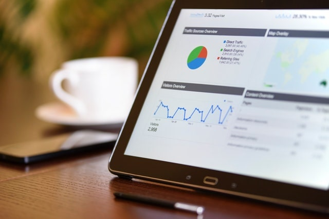 Website Analytics on Tablet Represents Increasing Traffic Via Email Newsletters