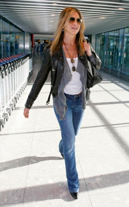 Jennifer Aniston wearing blue jeans &  leather jacket over a simple white t- shirt