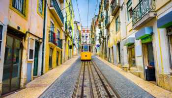 Lisbon, Portugal old town streets and street car.