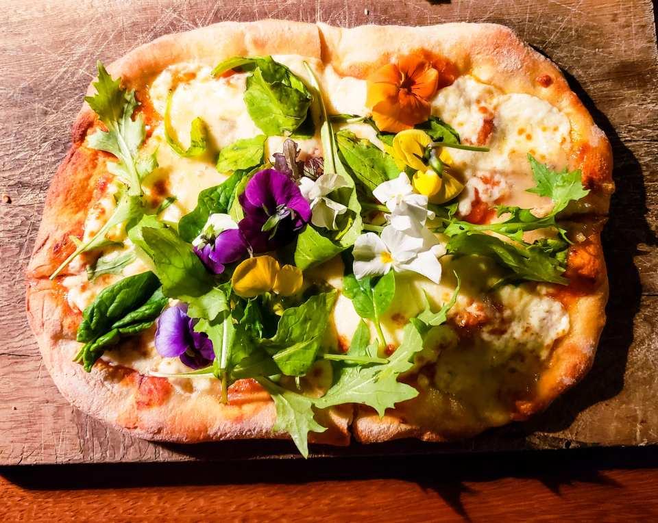 Patagonzola, mozzarella, greens and flowers pizza