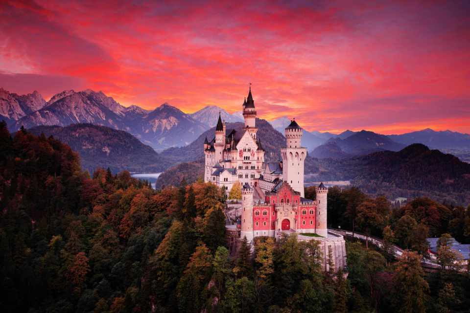 Red sky evening with castle. Beautiful sunset view of the