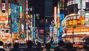 Tokyo, Japan - Jan 11, 2019: Crowded people and car traffic at Kabukicho, entertainment night life and red-light district in Shinjuku Tokyo