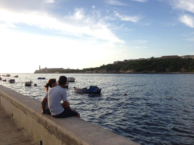 A couple admires the view from the Malecón.