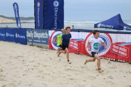 Junior Surfers runners racing to the finish line
