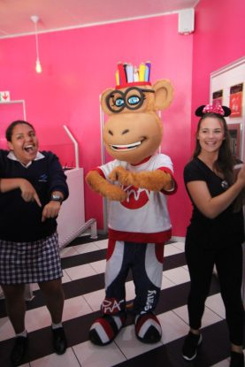 Farah Fleitas and Dann Du Preez dancing with Penny the Massoct of PNA Stationers