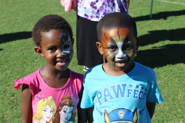 mange Mabandla and Unathi Mabandla have their faces painted during the carnival
