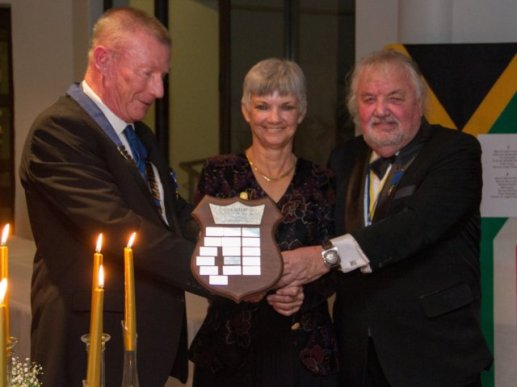 TEAM PLAYERS: David De'Ath, left, presents the Rotarian of the Year award to winner Lynne Hall and Bob Clayton