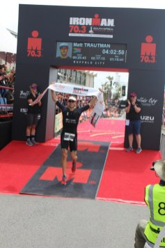 MEN'S CHAMPION: Cape Town's Matt Trautman crosses the finish line as the overall winner of the Ironman 70.3 SA
