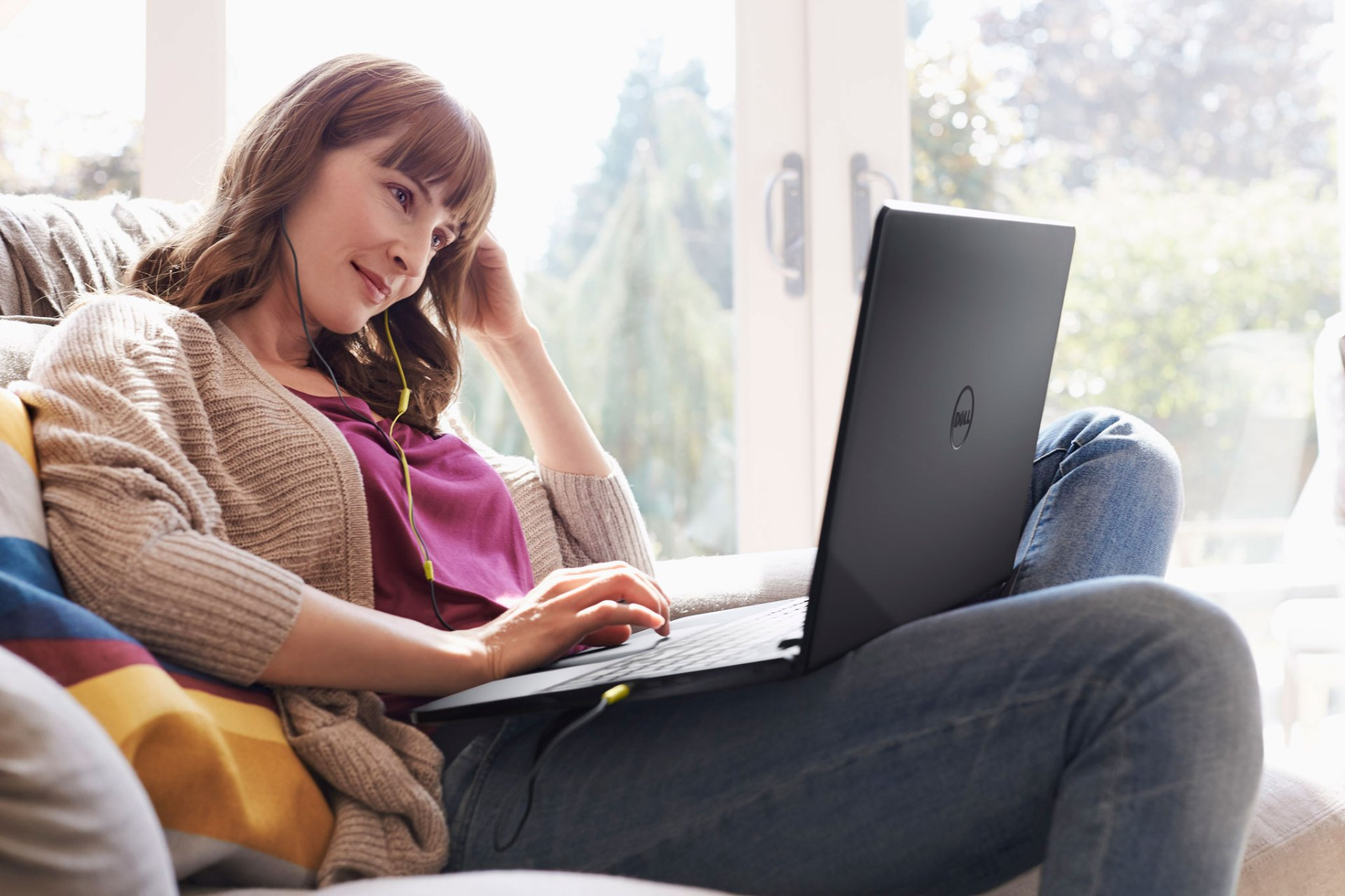 Woman Sitting on Couch Using Inspiron 14 3000 Series Notebook