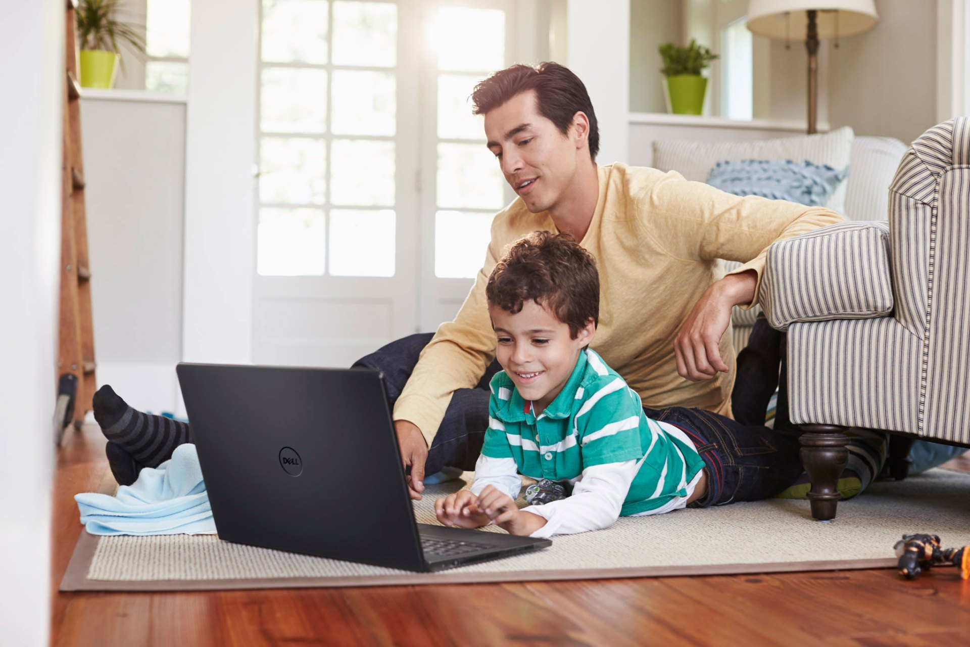 Father and Son Using Inspiron 14 3000 Series Notebook on Floor