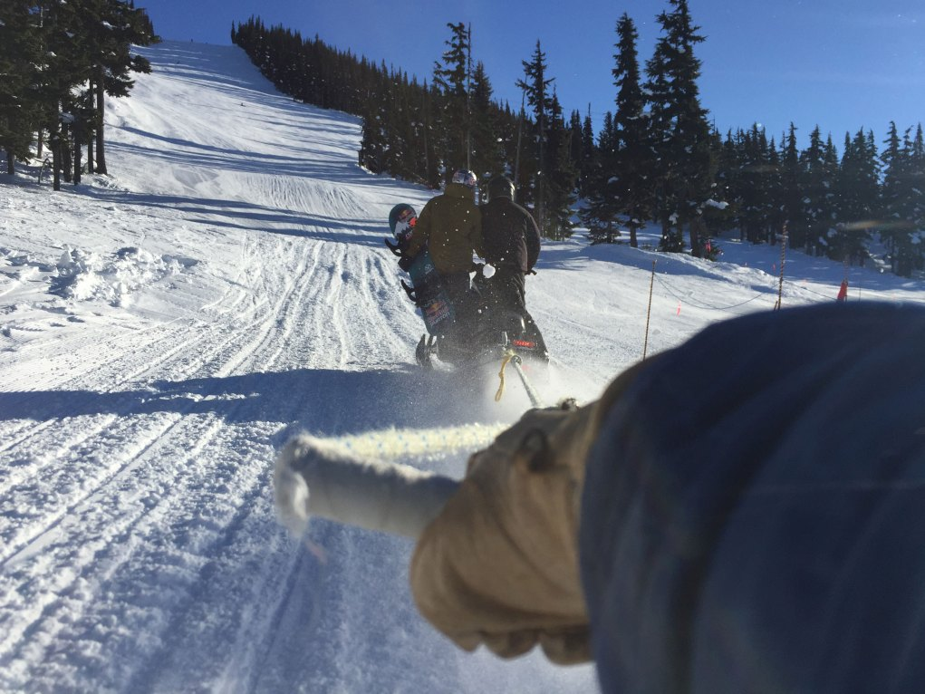 Producer Sean Frith on a Sled on a whistler production with Mark McMorris