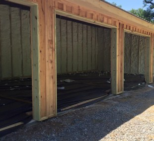 Large garage being insulated with spray foam
