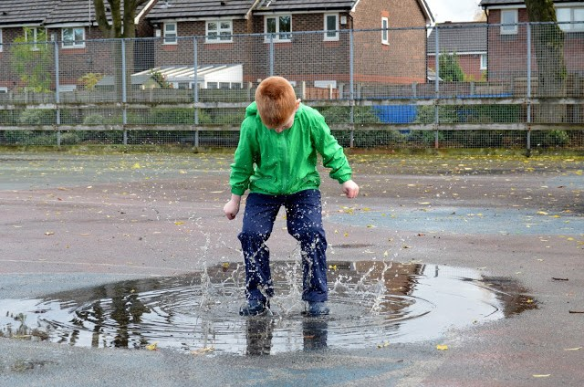 Jumping in puddles wearing Muddy Puddles Puddlefleece Trousers