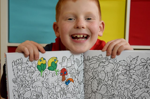 boy showing his colouring in
