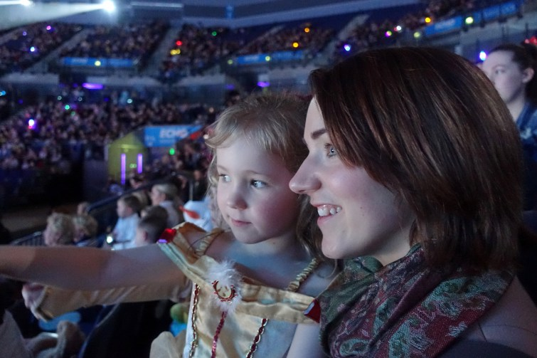 Mother and daughter watching Disney on Ice, Worlds of Enchantment