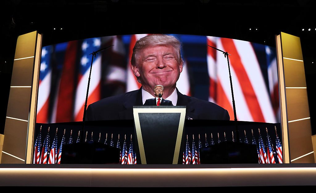 CLEVELAND, OH - JULY 21: Republican presidential candidate Donald Trump delivers a speech during the evening session on the fourth day of the Republican National Convention on July 21, 2016 at the Quicken Loans Arena in Cleveland, Ohio. Republican presidential candidate Donald Trump received the number of votes needed to secure the party's nomination. An estimated 50,000 people are expected in Cleveland, including hundreds of protesters and members of the media. The four-day Republican National Convention kicked off on July 18. (Photo by John Moore/Getty Images)