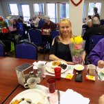 Woman with flowers at senior lunch
