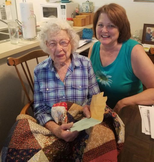 meals on wheels volunteer with birthday gift