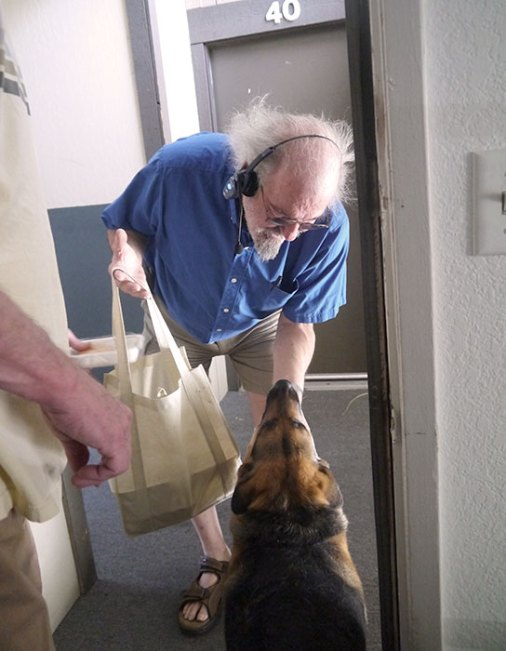 pet food pantry volunteer delivering food