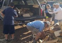 firewood volunteers loading trucks for delivery