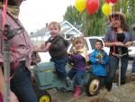 Walker Crawford, Mari Hill and Hector Pena on Spud Festival float