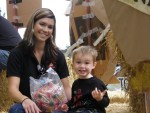 Lexi Crawford with her son, Walker, on the Gold Dust Potatoes parade float