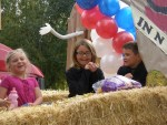 Rory Hill with Emma and TJ Chavez on the Gold Dust Potatoes parade float.