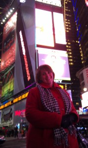 Tricia Hill taking in the bright lights and billboards of Times Square