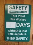 Sign showing that Gold Dust Potato Processors' packing shed crew has gone 125 days without an injuy.