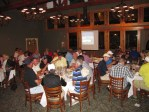 Guests visit during dinner at the Running Y Ranch Club House.