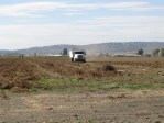A potato truck leaves a potato field near the Gold Dust Potatoes campus in Malin, OR.