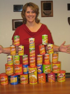 Tricia Hill poses with a pyramid of Shoestring Potatoes provided by Pik-Nik Foods of Burlingame, CA.