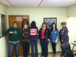 Gold Dust office employees show off their Christmas sweaters for the annual ugly Christmas sweater contest.